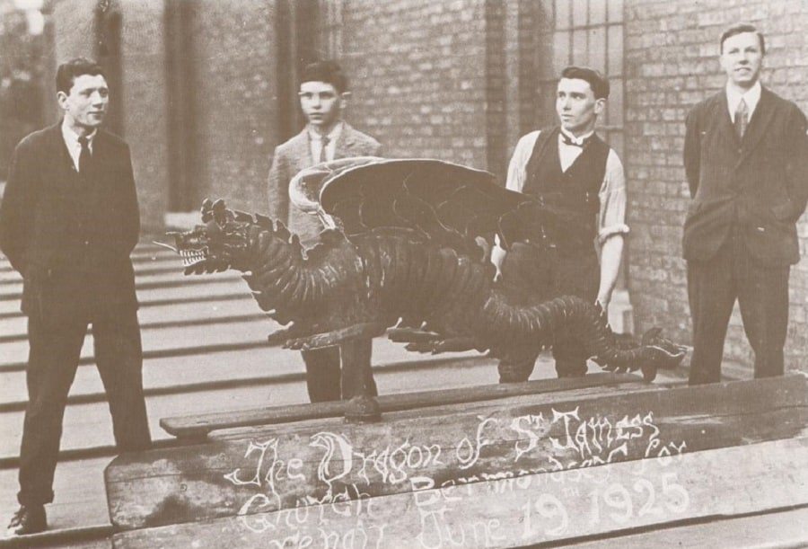 The dragon pictured when it was brought down from the top of St James' in 1925