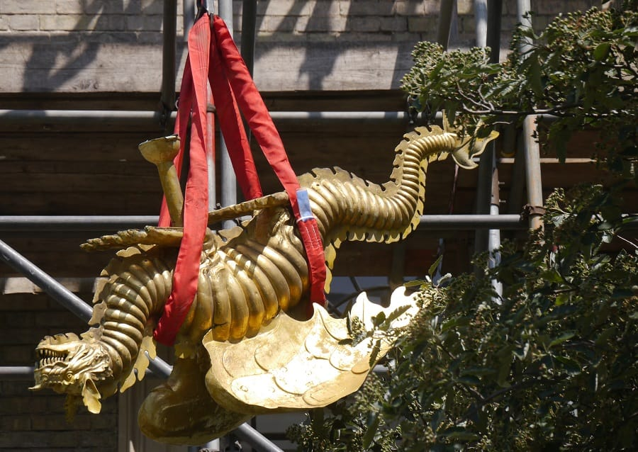 The golden dragon weather vane is brought down from the top of St James' Church, in Bermondsey, for repair work (Sandra Price)