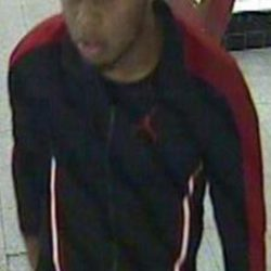 A CCTV still of the other man who may have information about the alleged robbery