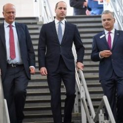 Transport Secretary Chris Grayling (left) and Network Rail chief executive Marc Carne (right) meet Prince William at London Bridge station
