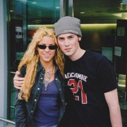 Malcolm and Shakira at the airport in 2002